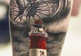 Lighthouse tattoo by Alexander Romashev