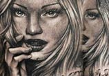 Woman angel tattoo by Benjamin Laukis