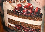 Tattoo of Food Cake by Benjamin Laukis