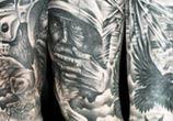 Full leg tattoo by Benjamin Laukis