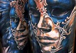 Perfect mask tattoo by Benjamin Laukis