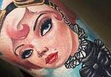 Tattoo of woman by Benjamin Laukis