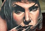 Woman on hand tattoo by Benjamin Laukis