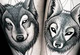 Wolf and Fox dotwork tattoo by Kamil Czapiga