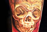 Skull tattoo by Nikko Hurtado