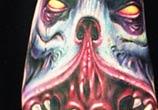 Feet monster tattoo by Paul Acker