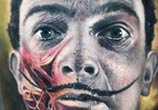 Salvador Dali portrait tattoo by Paul Acker