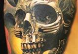 Green Skull tattoo by Sergey Shanko