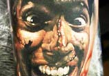 Horror funny face tattoo by Sergey Shanko