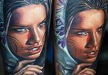 Woman with clocks tattoo by Sergey Shanko