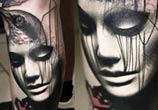 Face with bird tattoo by Timur Lysenko