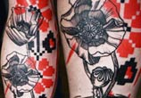 Poppy flowers tattoo by Timur Lysenko