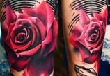 Red rose tattoo by Timur Lysenko